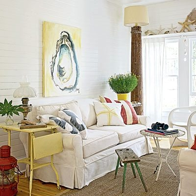 oyster painting above slip covered sofa