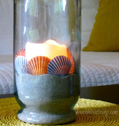 Candle in Glass Vase and Glowing Shells