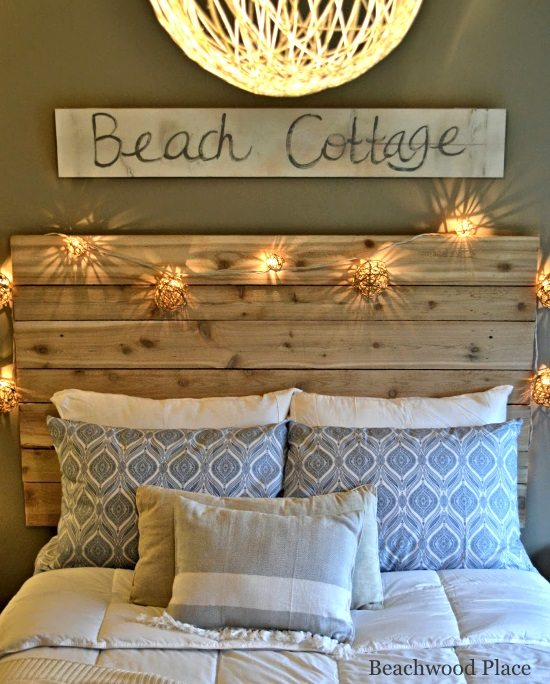 Beach Theme Guest Bedroom With DIY Wood Headboard Wall Art And Lots Of Anni