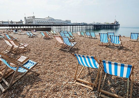 Brighton Beach with Deck Chairs and Pier