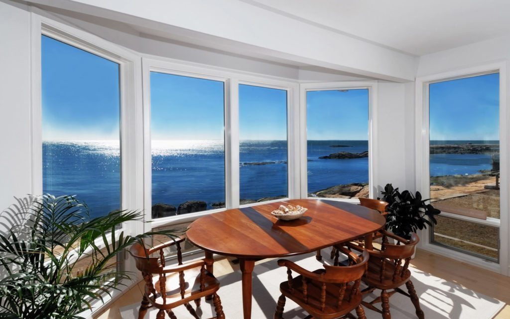 http://www.blucarrot.com/wp-content/uploads/2015/06/Beach-Apartment-Interior-Design-Come-With-Varnished-Wooden-Dining-Chair-And-Round-Wooden-Dining-Table-With-Beach-View-Bay-Window.jpg