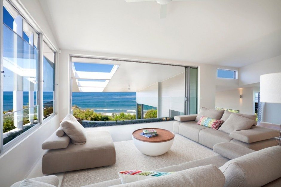 http://ontrus.com/wp-content/uploads/2014/09/cool-beach-house-with-modern-interior-design-ideas-also-cream-sectional-sofa-and-round-coffee-table-as-well-as-glazed-window-plus-sea-view.jpeg