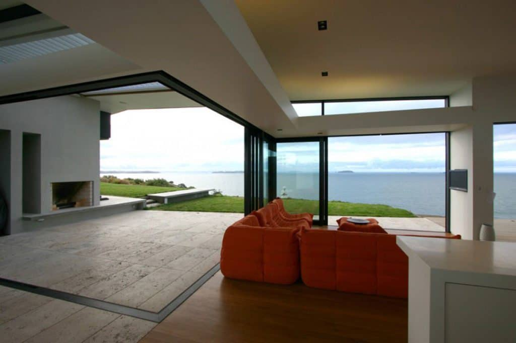 http://www.oftrax.com/wp-content/uploads/2015/03/minimalist-home-interior-design-ideas-red-sofa-fabric-and-cushion-wooden-flooring-tile-view-outside-beautiful-beach-glass-window-minimalist-home-design-home-design-outdoor-interior-luxury-modern-hous.jpg