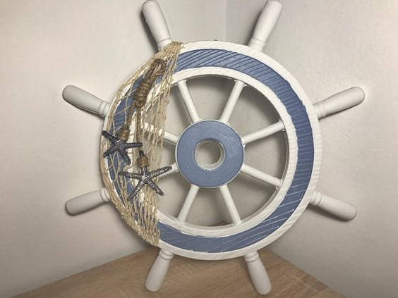 net with starfish on a ships wheel