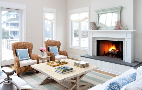 washed wood coffee table in front of a beach fireplace