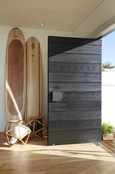 wood panels with pacific carved in front door