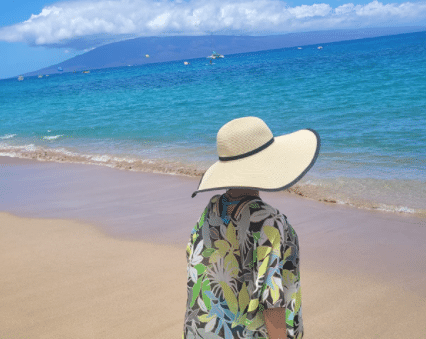 Bask in the warm glow of the sun with a wide brimmed floppy hat to shield your eyes.